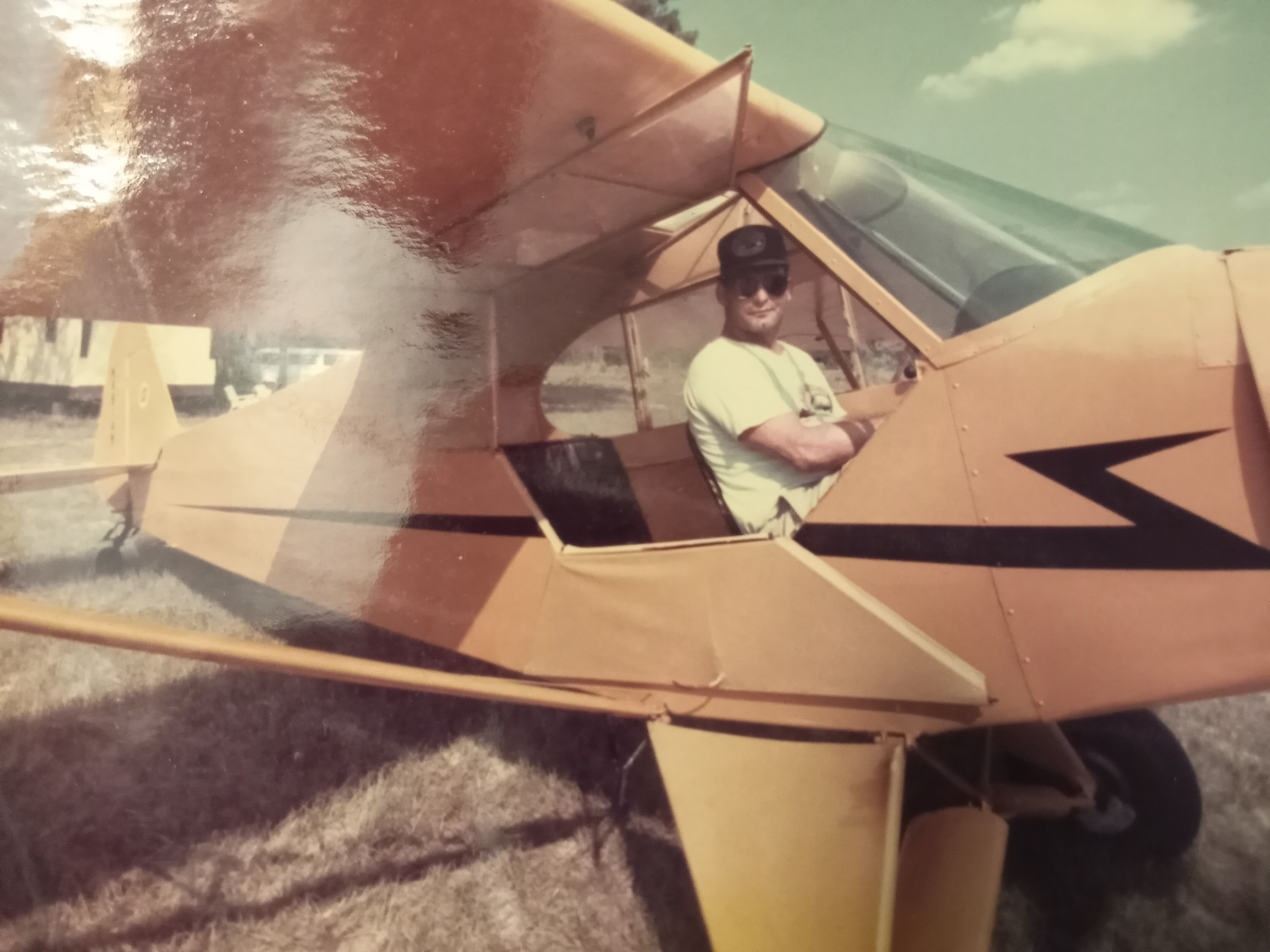Rocky ready to take off in a J-3 Cub just like uncle Paul's.